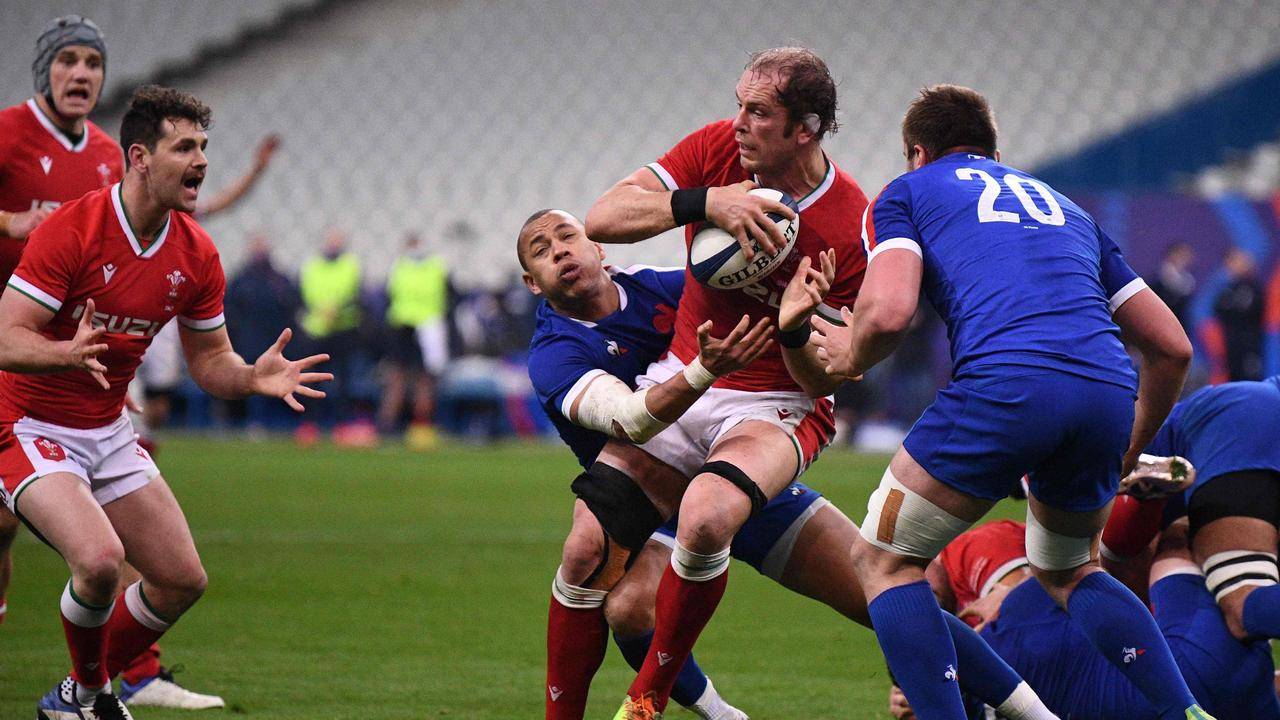 Wales' lock Alun Wyn Jones (2R) missed out on becoming the fourth player to win four Six Nations grand slams after narrow defeat to France on Sunday.