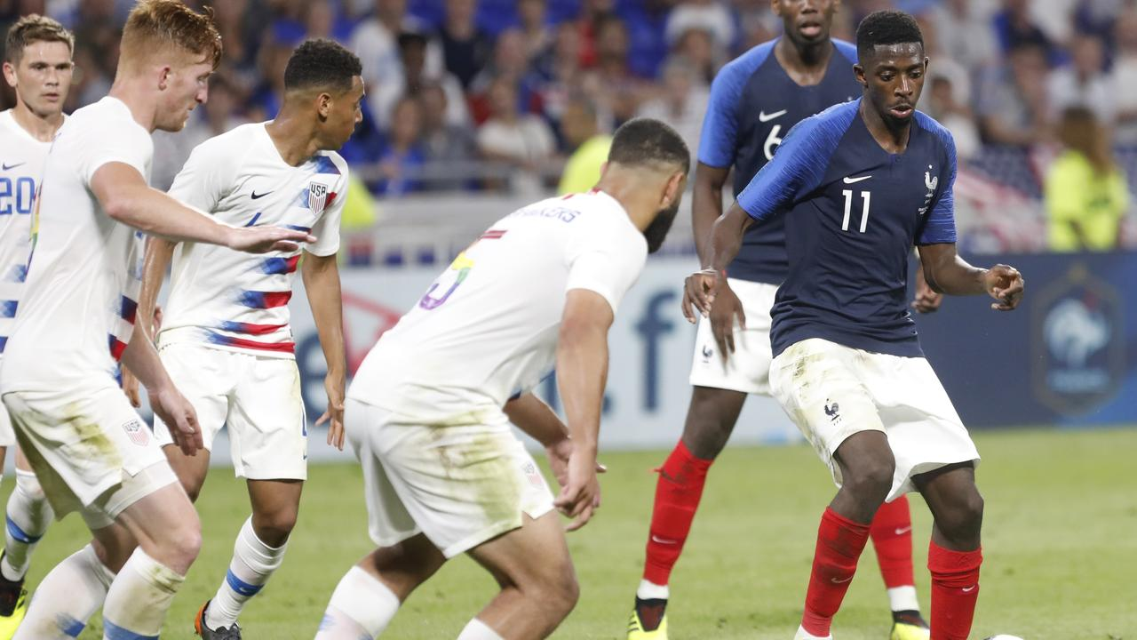 France's Ousmane Dembele controls the ball ahead of United States' Cameron Carter-Vickers.