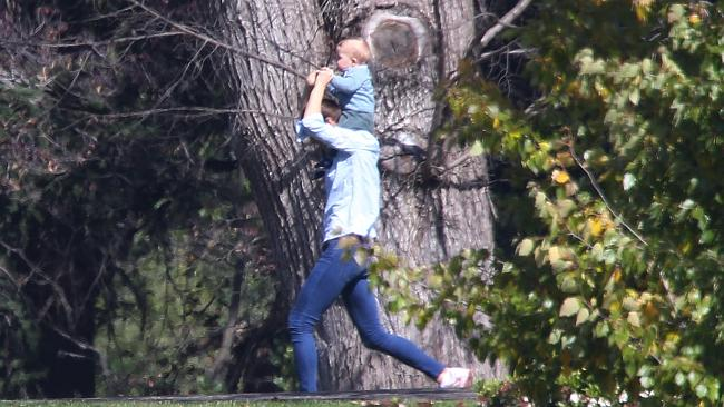 The Duchess of Cambridge strolls around the grounds of Government House with her young son Prince George riding high on her shoulders. Picture: News Corp