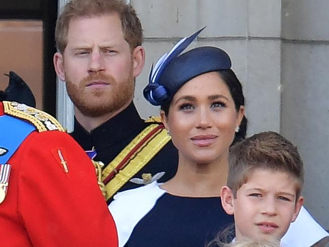 Royal watchers were convinced Harry and Meghan were having a marital tiff on the Buckingham Palace balcony during Trooping the Colour. Picture: AFP