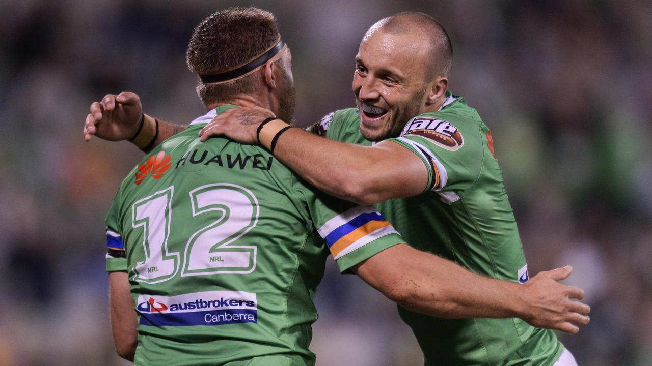 Elliot Whitehead and Josh Hodgson celebrate a try in the Raiders victory over the Eels.