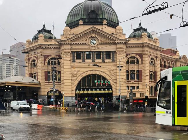 Melbourne's busiest intersection lies underwater after a storm brought flash flooding. Picture: Twitter