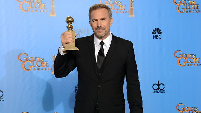 "Kevin Costner poses with the award for best performance by an actor in a mini-series or a motion picture made for television for ""Hatfields & McCoys"". Picture: Jordan Strauss/Invision/AP"