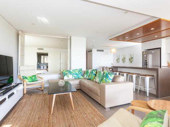 The beachside apartment will go under the 'virtual hammer' this month with a part of the proceeds of the sale going towards cancer research. Photo: North South Real Estate