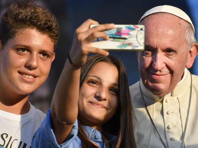 Pope Francis poses for selfie photos with youth. Picture: AFP