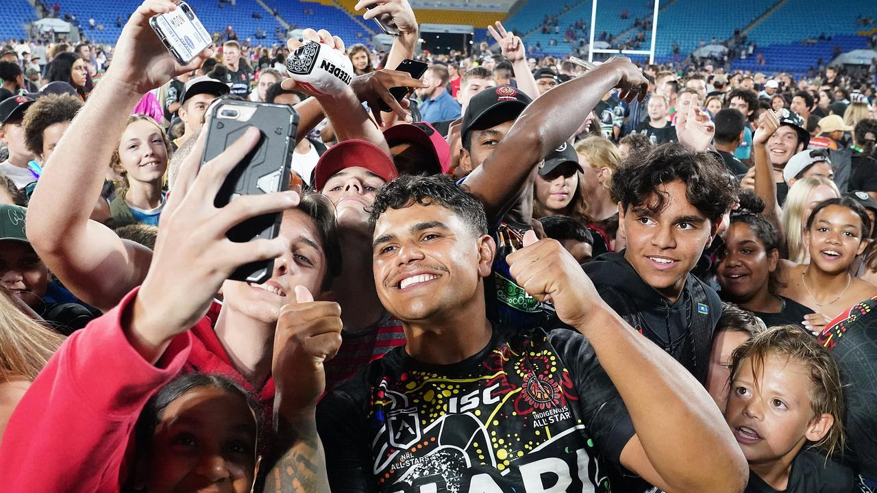 Latrell Mitchell poses for photographs with fans following the NRL Indigenous All-Stars vs Maori Kiwis match