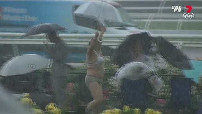 Woman strips down to underwear, runs around in the rain at Oaks Day