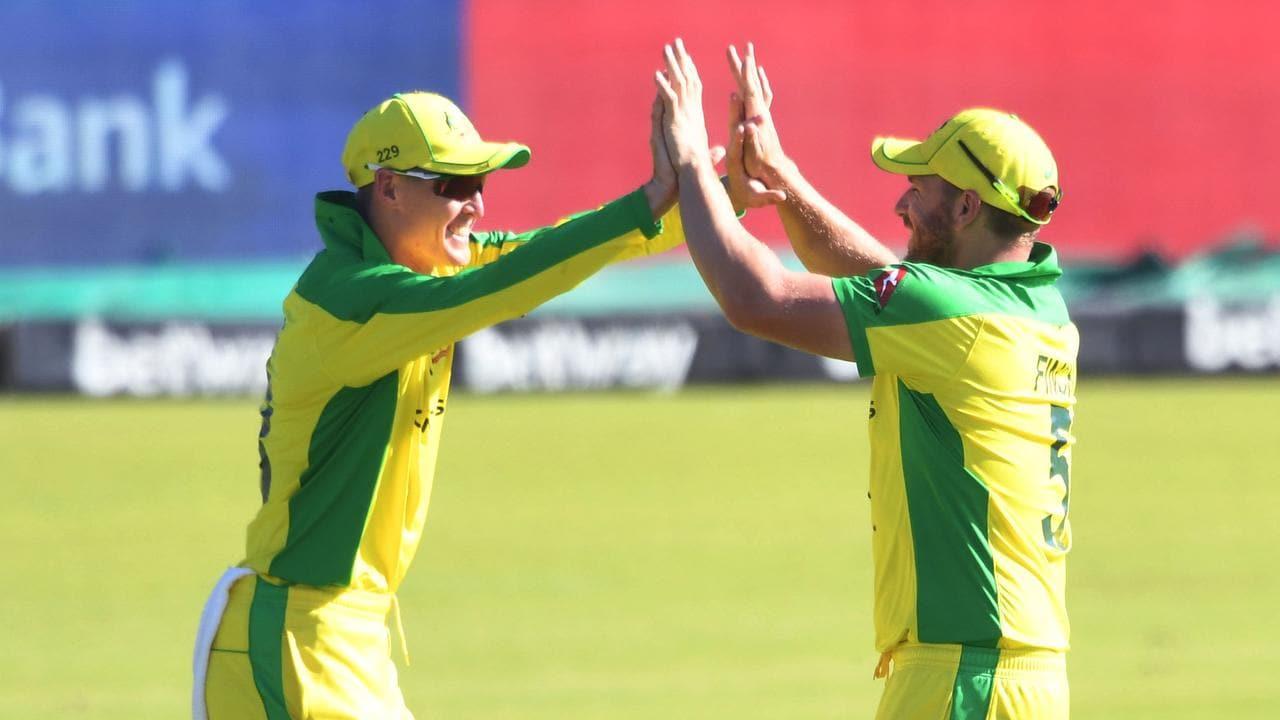 Marnus Labuschagne and Aaron Finch of Australia celebrate the wicket of Kyle Verreynne.