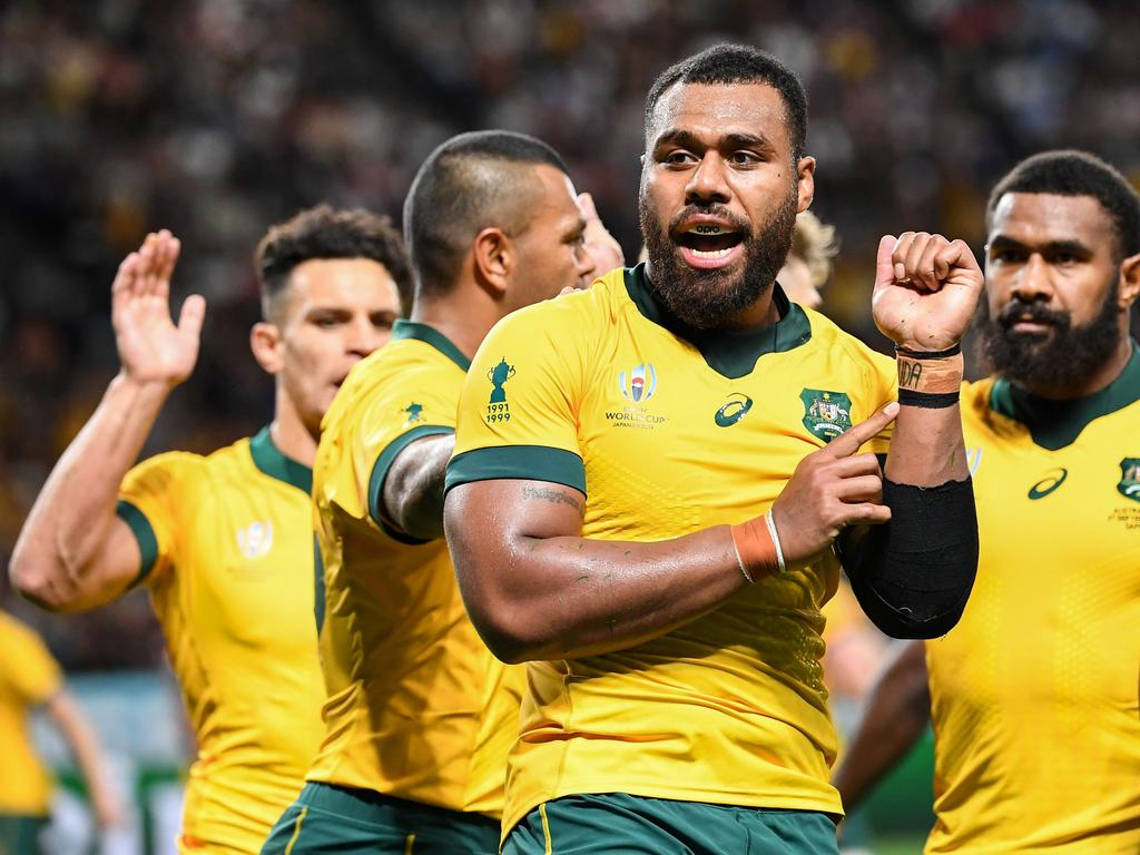 Australia's centre Samu Kerevi celebrates scoring a try during the Japan 2019 Rugby World Cup Pool D match between Australia and Fiji at the Sapporo Dome in Sapporo on September 21, 2019. (Photo by WILLIAM WEST / AFP)