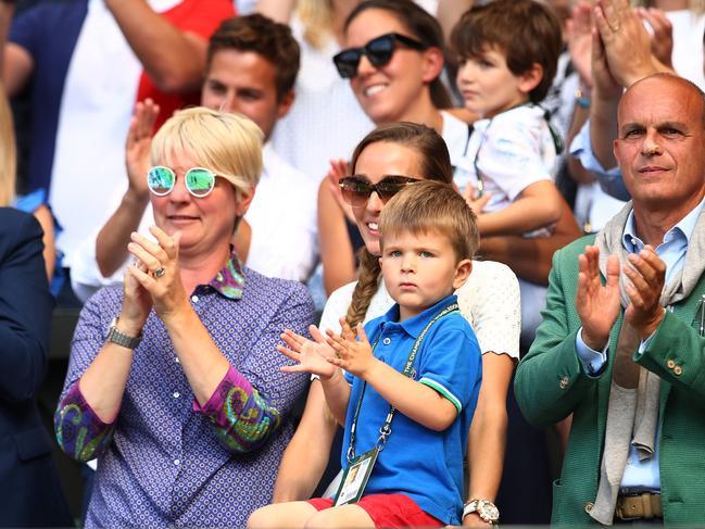 Jelena Djokovic, wife of Novak Djokovic, and their son Stefan Djokovic applaud after the Men's Singles final in 2018.