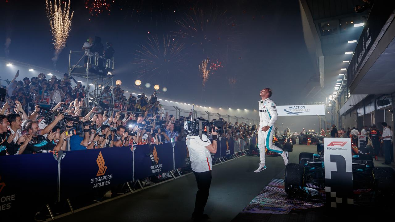 Lewis Hamilton has firmed his grip on a fifth world championship by winning the Singapore Grand Prix on Sunday night.
