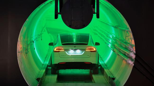 A modified Tesla Model X drives into the tunnel entrance before an unveiling event for the Boring Company Hawthorne test tunnel in Hawthorne, south of Los Angeles, California. Picture: Robyn Beck
