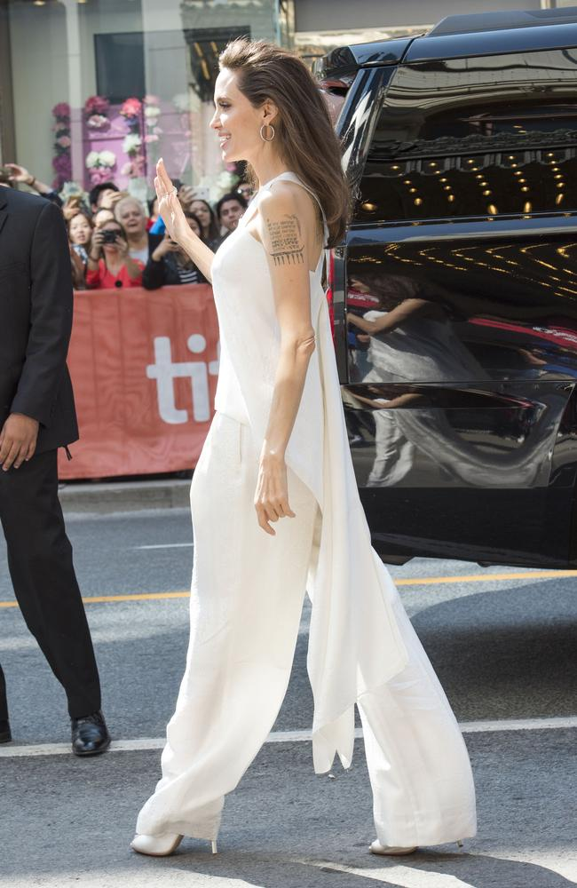 Jolie looks elegant in a relaxed white ensemble as she arrives at the premiere.