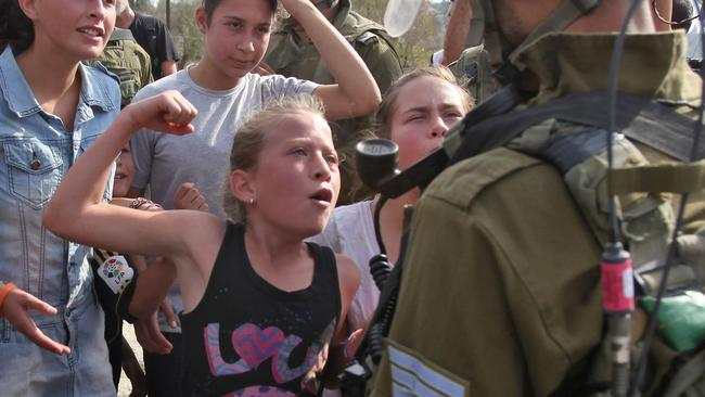 Ahed Tamimi has a history of conflict with Israeli soldiers. This photo was taken in 2012. Picture: AFP/Abbas Momani