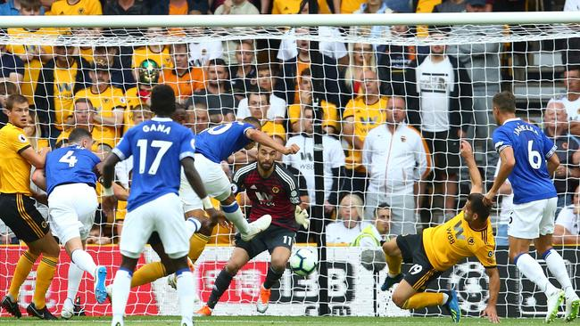 Everton's Brazilian striker Richarlison (C) scores the opening goal during the English Premier League football match between Wolverhampton Wanderers and Everton at the Molineux stadium in Wolverhampton. Picture: AFP