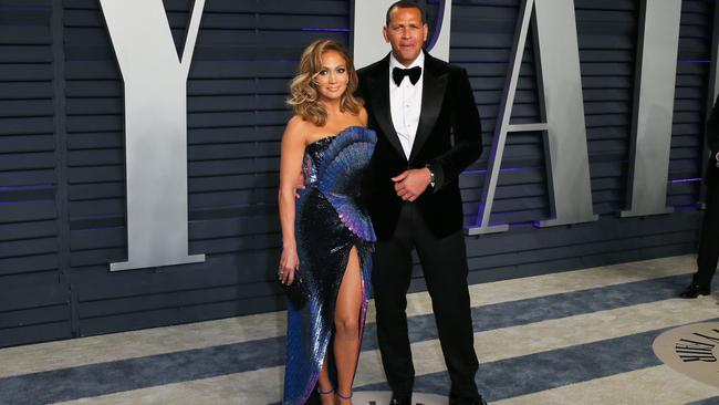 Jennifer Lopez and former pro-baseball player Alex Rodriguez attend the 2019 Vanity Fair Oscar Party in 2019. (Photo by JB Lacroix / AFP)