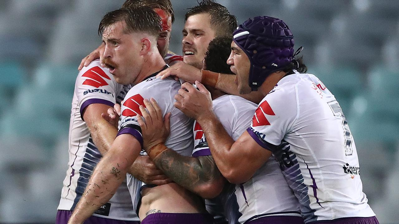 The Storm celebrate a try that snatched the lead from the Rabbitohs. (Photo by Cameron Spencer/Getty Images)