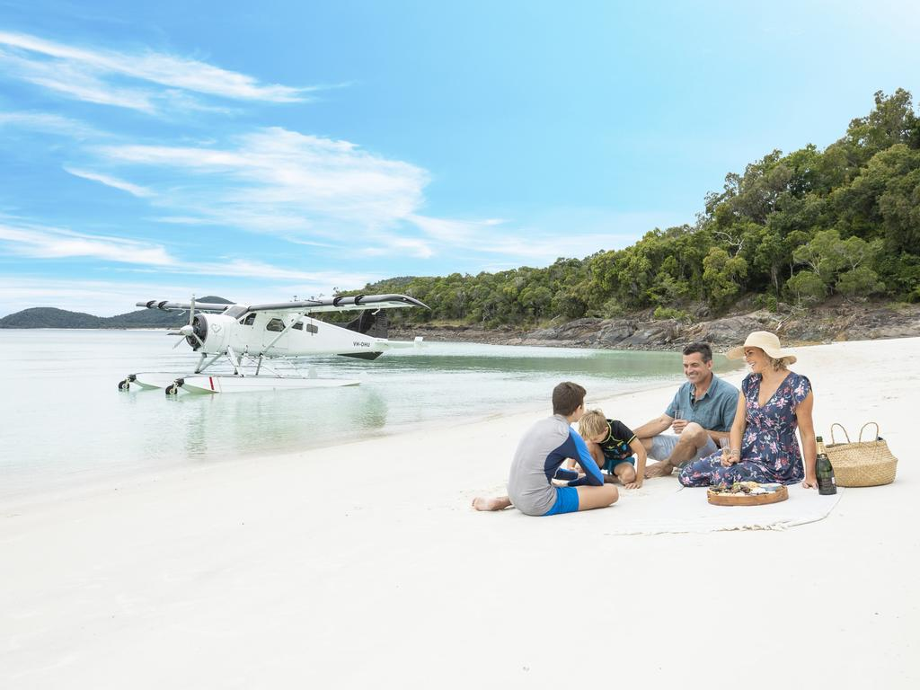 Australia's iconic beaches of Whitehaven (pictured) on the Whitsundays, Hyams on the NSW south coast and even Bondi and Manly in Sydney are undeniably popular Picture: Tourism and Events Queensland