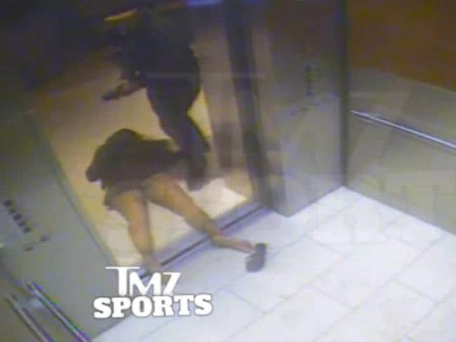 In this still Rice drags his then-fiancee out of an elevator moments after knocking her off her feet into the elevator's railing.