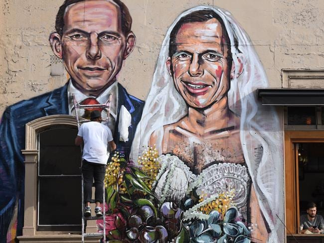 Same-sex marriage activists have targeted Mr Abbott before. Artist Scott Marsh painted a mural of the former PM getting married to himself at Hunters Corner in Redfern, Sydney. Picture: AAP