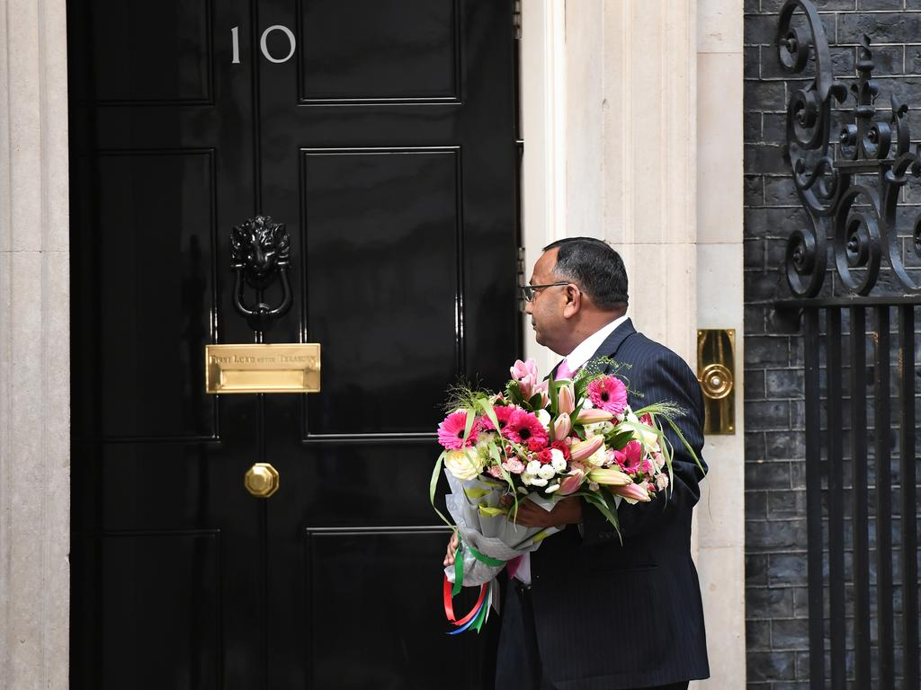 Flowers are delivered to Downing Street as British prime Minister Boris Johnson remains in hospital. Picture: Getty Images