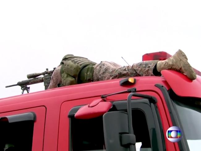 The police sniper that took out the gunman positioned on top of a fire truck. Picture: Supplied