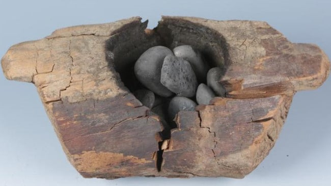 Brazier and burnt stones found in the ancient Chinese tomb. Picture: Xinhua Wu