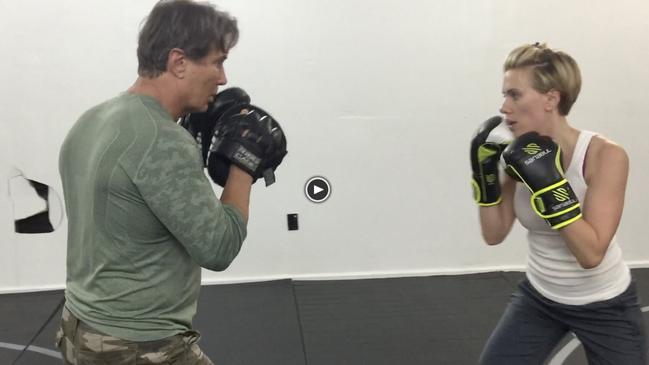 Australian martial arts expert Richard Norton training with Scarlett Johansson. The Johnson brothers suggest boxing instead of burpees to keep the heart rate pumping. Picture: Supplied.