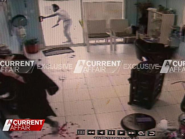 Terror suspect Ihsas Hkan, 22, is allegedly shown trying to force his way into the Minto hair salon where a badly injured Wayne Greenhalgh, whose blood can be seen in the foreground, has sought refuge. Picture: A Current Affair/Channel 9