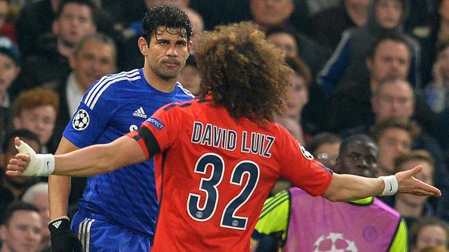 Paris Saint-Germain's Brazilian defender David Luiz goes with Diego Costa.