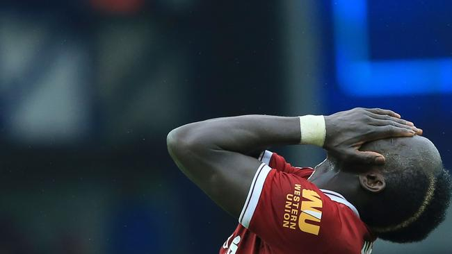 Liverpool's Senegalese midfielder Sadio Mane reacts after failing to score