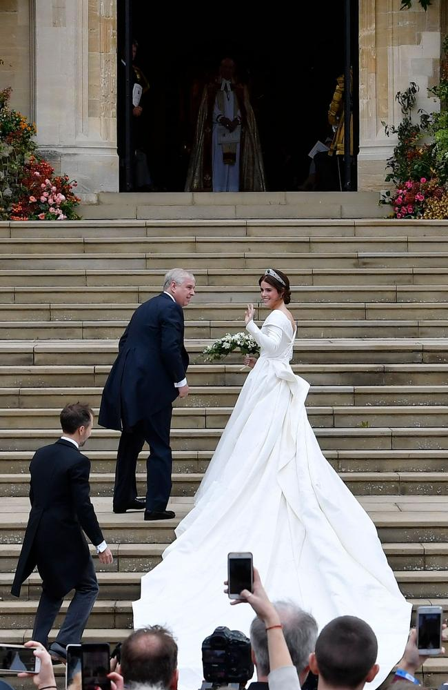 The beautiful bride wore a dress by a British designer. Photo: Toby Melville/Pool/AFP)