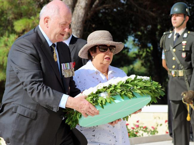 Tribute ... Australian Governor-General Sir Peter Cosgrove and his wife Lynne lay a wreath to soldiers of Turkey's 57th Regiment during a memorial to commemorate the 100th anniversary of the Battle of Lone Pine at Anzac Cove. Picture: AAP