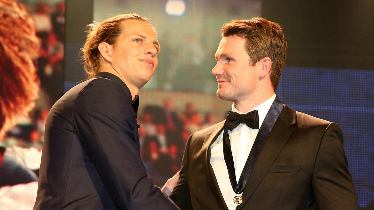 Nat Fyfe presents Patrick Dangerfield with the 2016 Brownlow Medal.