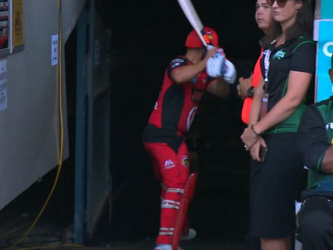 Aaron Finch prepares to demolish a chair after dismissed.