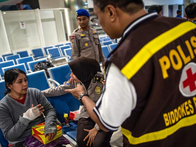 A passenger of a ferry that caught fire receives a medical treatment after being evacuated, at Tangjung Perak seaport, in Surabaya, East Java. Picture: AFP