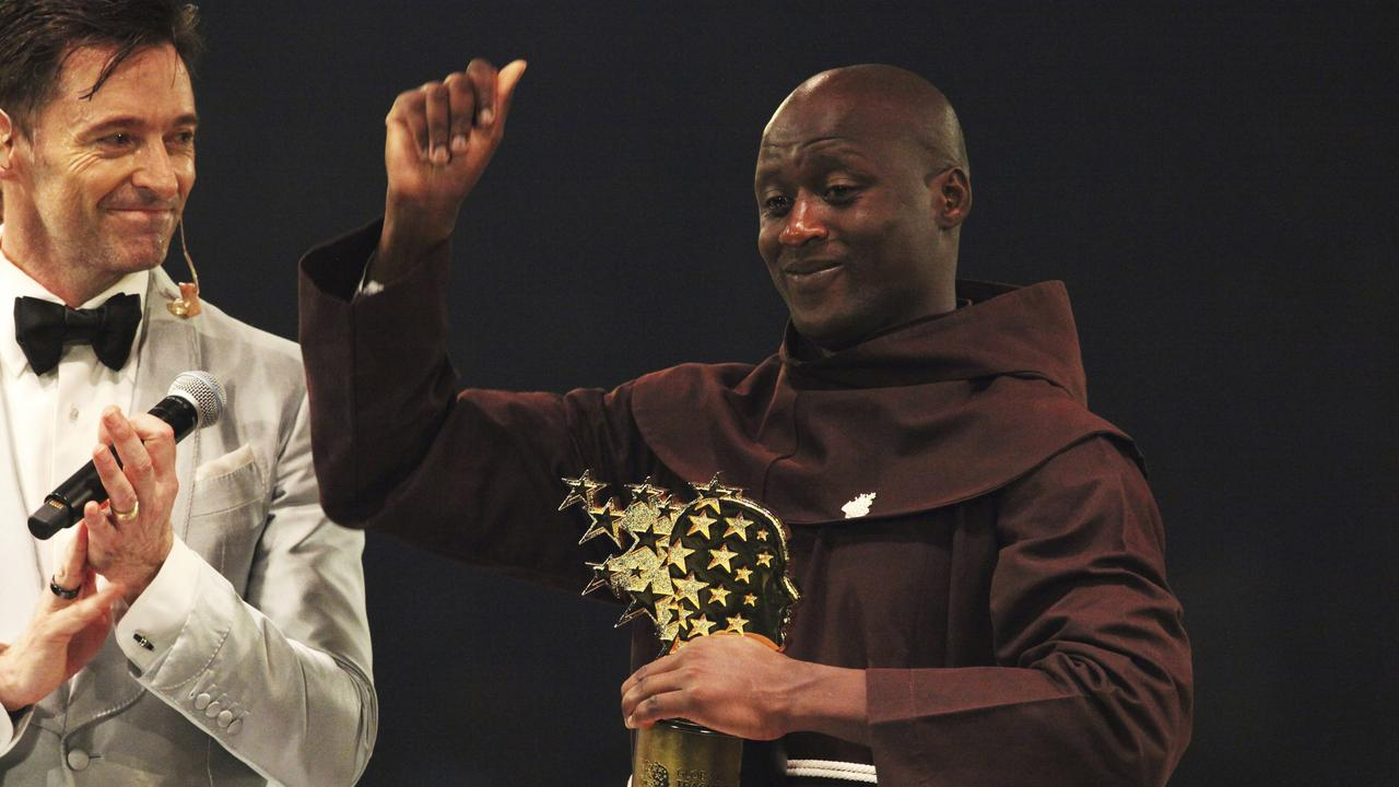 Australian actor Hugh Jackman applauds Kenyan teacher Peter Tabichi, who gives away 80 per cent of his income to the poor in the remote Kenyan village of Pwani. Picture: AP