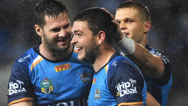 Ashley Taylor is congratulated for a Titans try in their win over the Sharks.