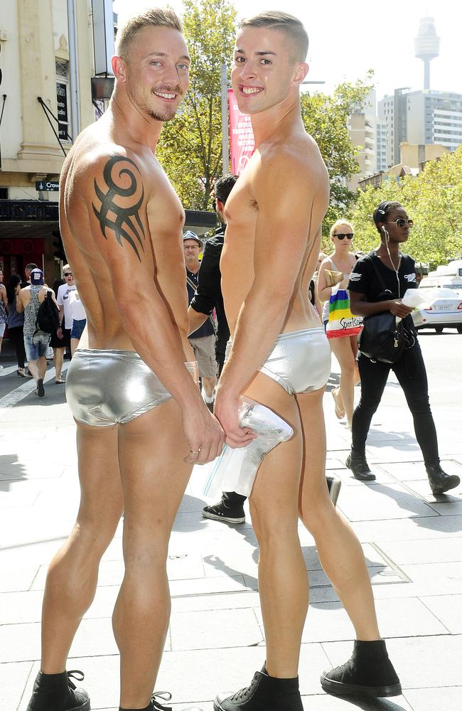 Mike Sinclair and Steven Capp make their way down Oxford St in Sydney in preparation for the Gay and Lesbian Mardi Gras parade. Photo: John Appleyard.