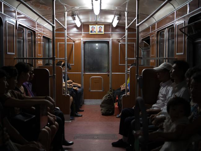 Pictures of Kim Il-sung and Kim Jong-il hang on the wall of a train carriage on the Pyongyang metro on August 21, 2018 in Pyongyang, North Korea. Picture: Carl Court/Getty Images