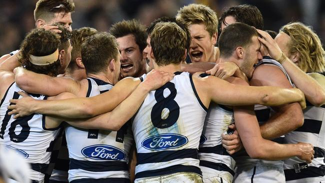 Geelong players celebrate after the game. Picture: AAP