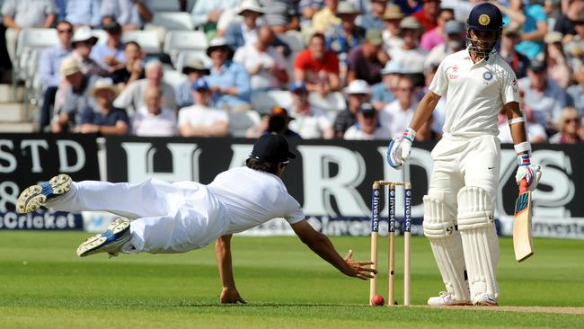 Alastair Cook fails with a diving attempt at a catch to remove Indian batsman Ajinkya Rahane.