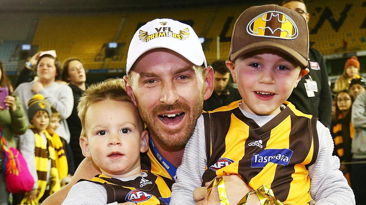 Brendan Whitecross and his kids celebrate after the 2018 VFL Grand Final. (Photo by Michael Dodge/AFL Media/Getty Images)