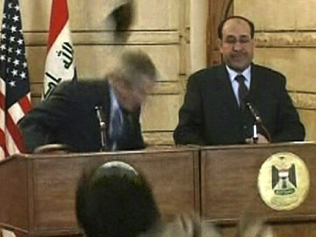 A man throws a shoe at President George W. Bush during a news conference with Iraq Prime Minister Nouri al-Maliki in Baghdad. Picture: AP