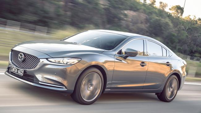 A new turbo engine highlights the updated stately sedan.