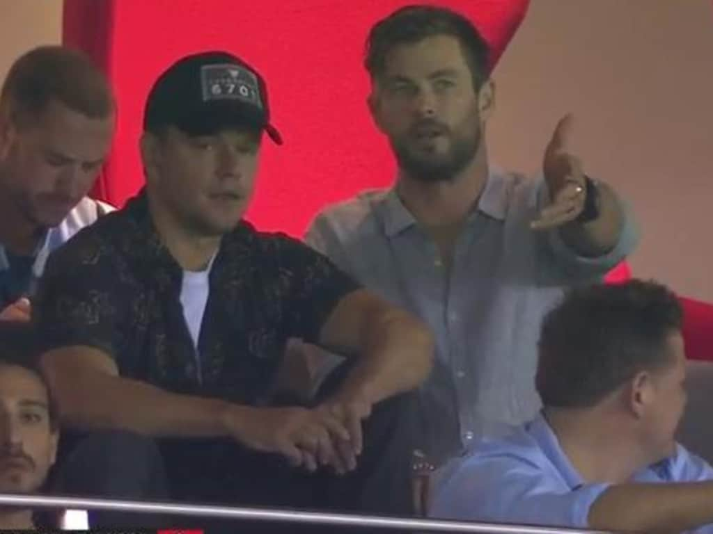 Matt Damon and Chris Hemsworth at an AFL game. Damon classifies Byron Bay as his second home.