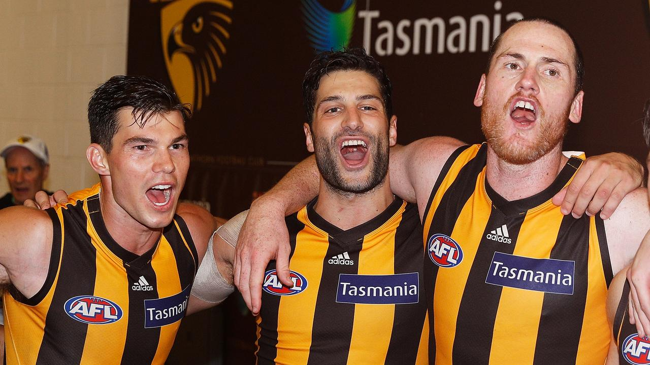 Jaeger O'Meara of the Hawks with debutant David Mirra and skipper Jarryd Roughead.