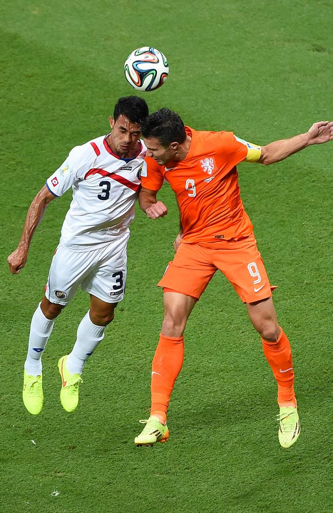 Giancarlo Gonzalez of Costa Rica and Robin van Persie of the Netherlands go up for a header during the 2014 FIFA World Cup quarter-final.