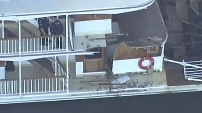 A woman was injured when she fell through the floor onto another person in the toilet on the boat. Picture: 7 News