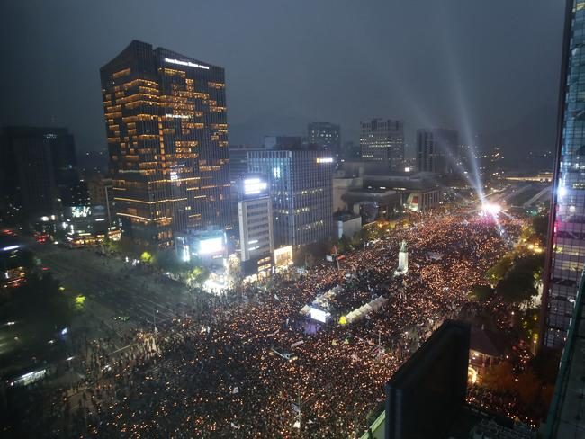 Thousands of Koreans took to the streets on Saturday. Picture: Chung Sung-Jun/Getty Images
